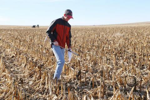 A ServiTech crop consultant collects soil during our grid sampling process